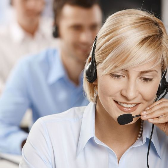 6374258 - portrait of young customer service operator talking on headset, smiling.